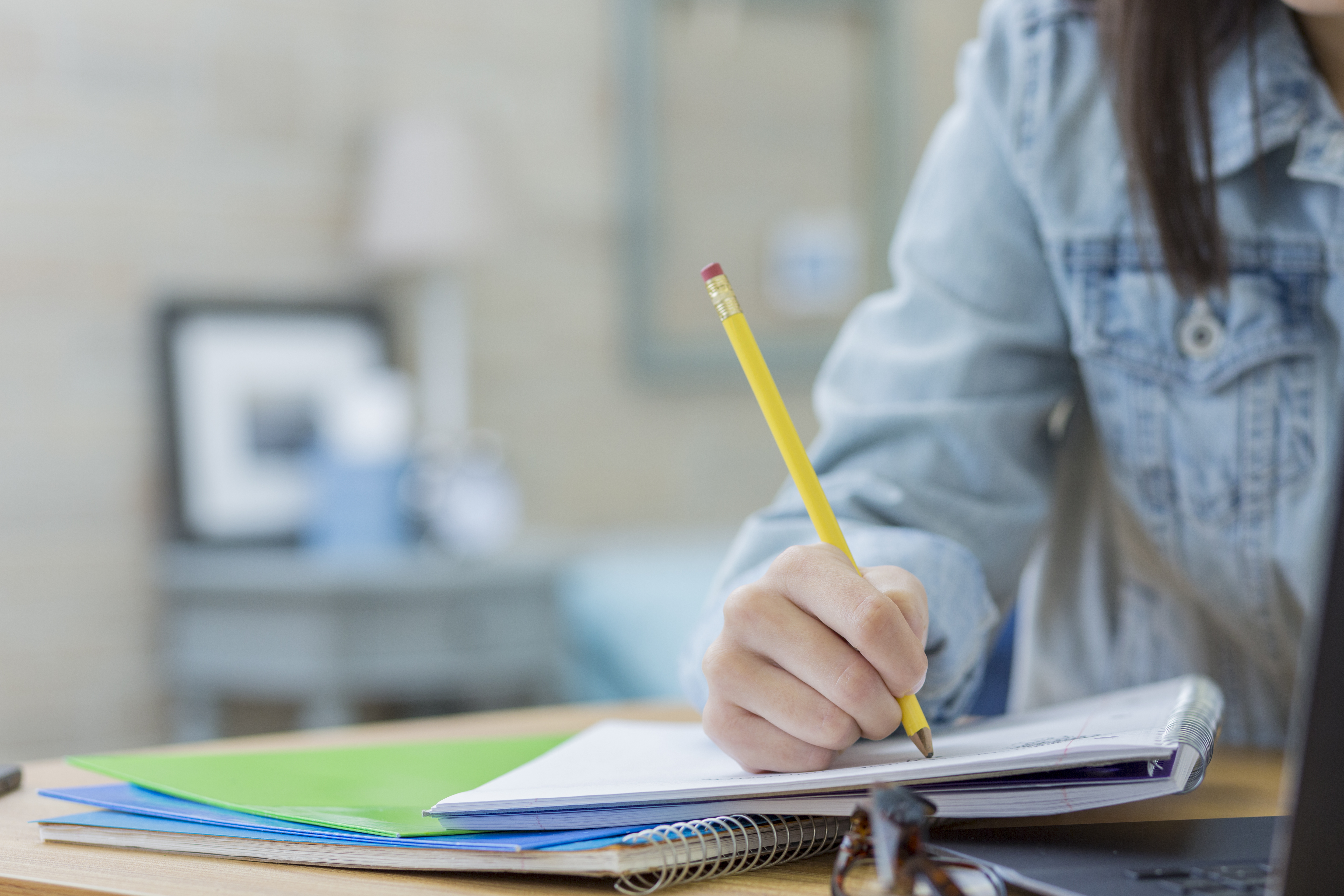Woman with pencil and notepad writing