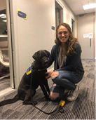 Seeing Eye Dogs Show presenter Harriet Moffat with a Seeing Eye Dog in harness just outside Vision Australia Radio studios